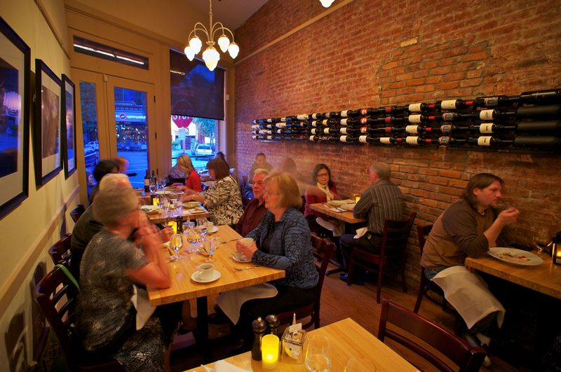 Carpe Vino Auburn Dining Room table tops are made from a recycled bowling alley lane  Photo Credit Keith Sutter