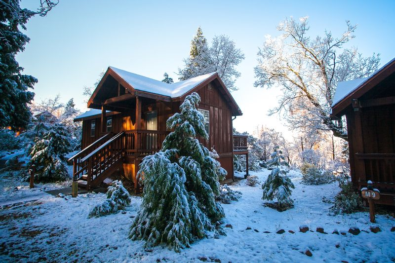 Evergreen Lodge Cabin in winter. Fully furnished and all the amenities is perfect for groups, families, friends - Kim Carroll Photography