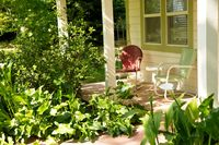 The Flower Farm cottages provides porch provdes shaded comfort on a summer day  Credit Andrea's Images
